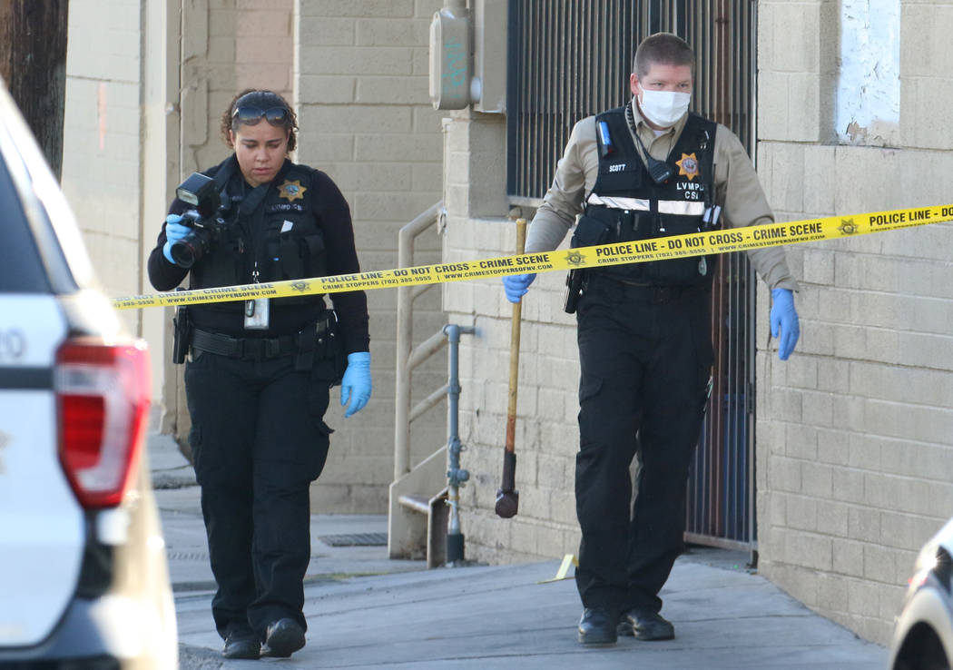 Las Vegas police are collecting evidence at the crime scene where a woman is killed by a sledge ...