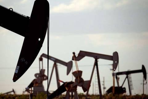 In an April 24, 2015, file photo, pumpjacks work in a field near Lovington, N.M. Oil industry ...