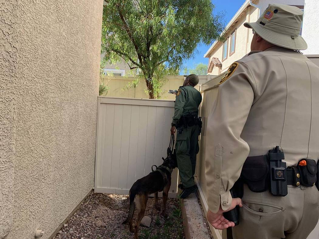 Las Vegas police investigate a stabbing in the 6500 block of Mocha Brown Court, near West Warm ...