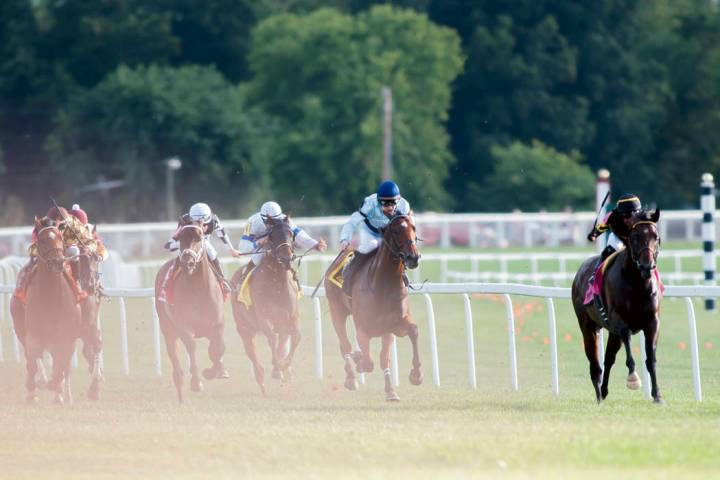 Julio Garcia, from right, riding Bound for Nowhere, and James Graham, riding Great Wide Open, l ...
