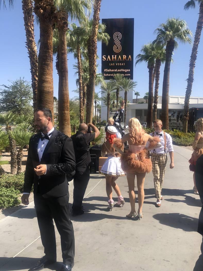 "The cast of ""Blanc de Blanc is shown at the Sahara Las Vegas sign on Thursday, Aug. 29, 2019. ( ..."