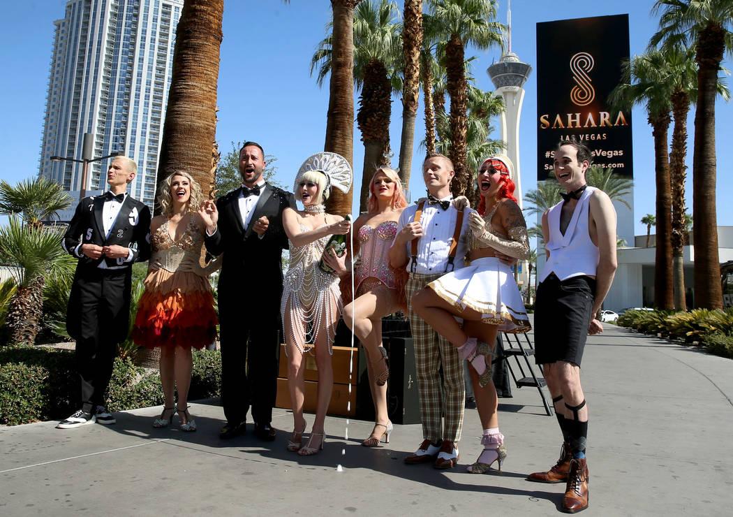 Cast members for Blanc de Blanc participate during the Sahara Las Vegas rebranding event outsid ...