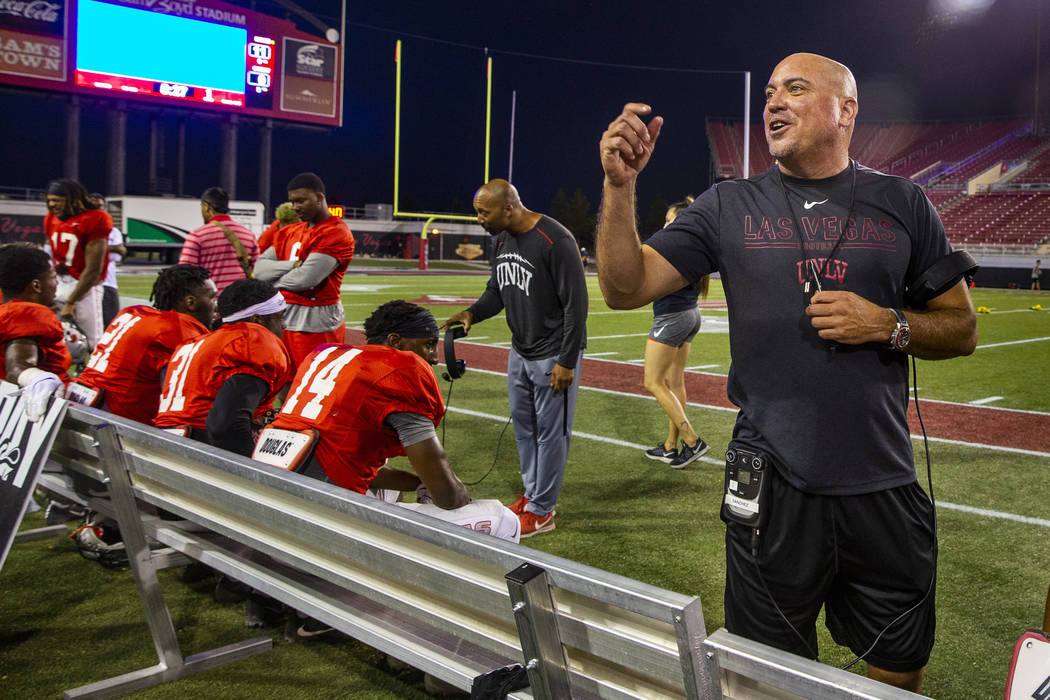 Head coach Tony Sanchez chats with fans in the stands during the UNLV football team scrimmage a ...