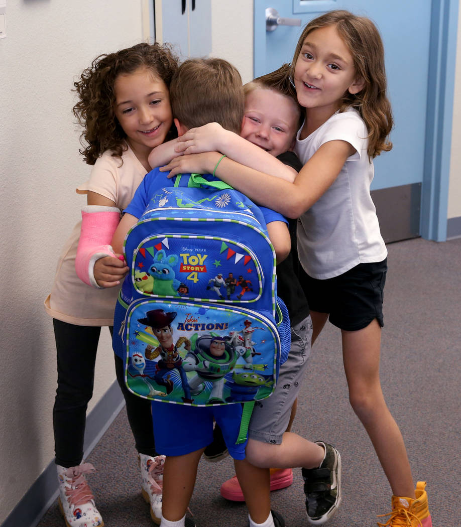 Students, from left, Willow Dennis, 5, Luca Pacella, 5, Daniel Carter, 5, and Elli Carter, 6, h ...