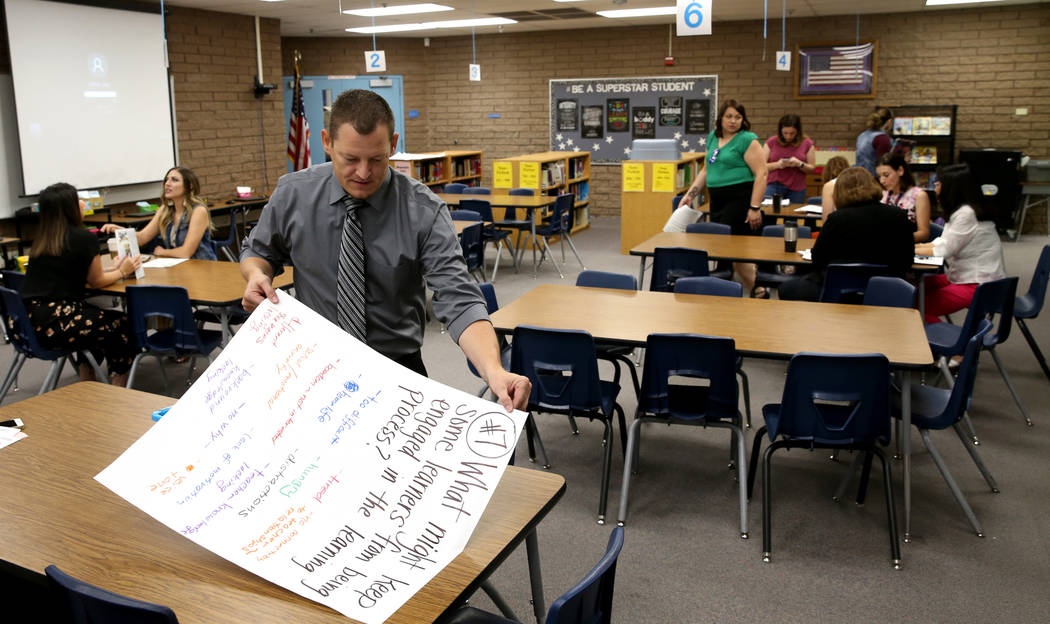 Helen Smith Elementary School Principal Robert Hinchliffe organizes displays after a meeting w ...