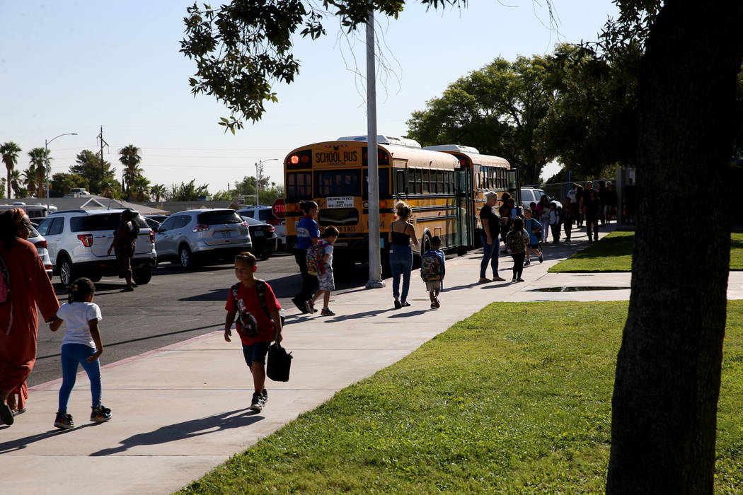 Students arrive at Helen Smith Elementary School in Las Vegas Thursday, Aug. 29, 2019, one day ...