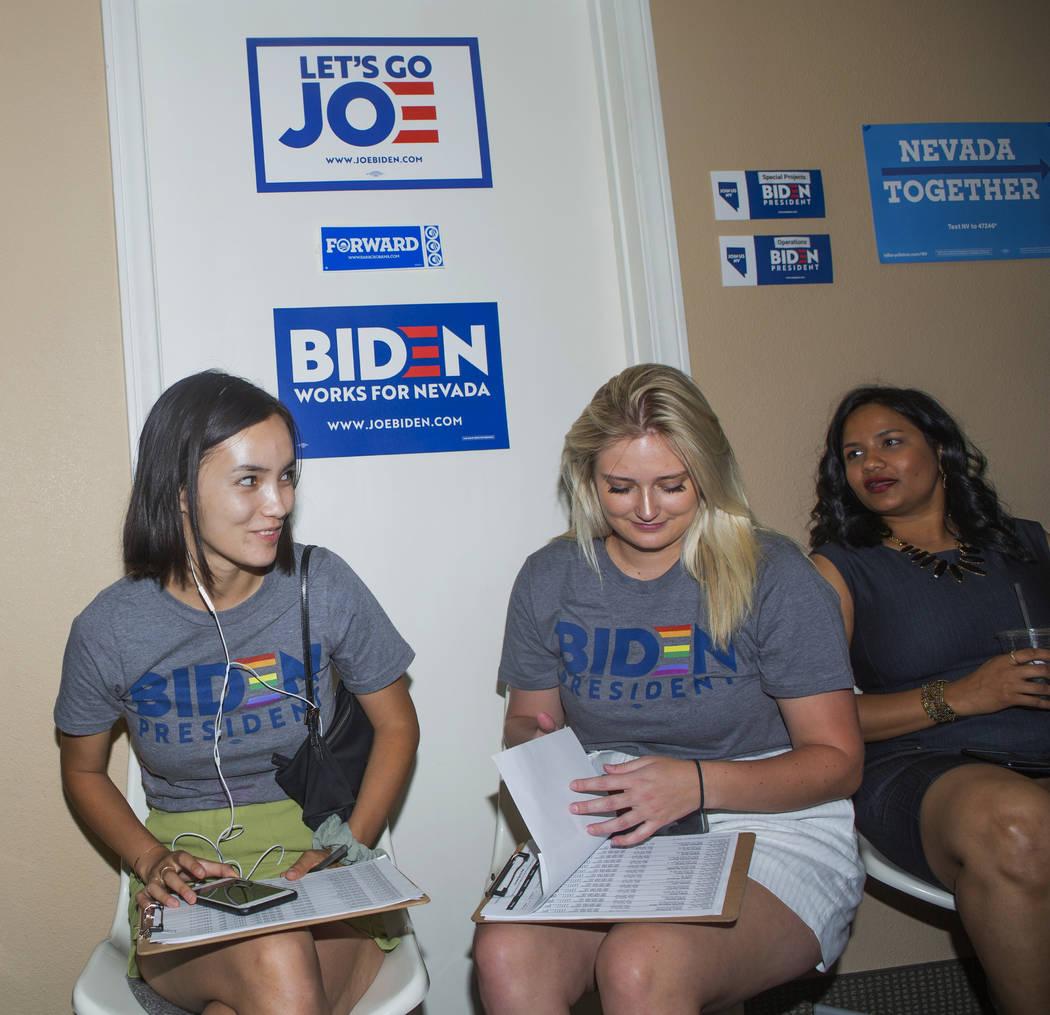 Joe Biden campaign staffers Mailinh McNicholas, left, Caroline Voelker, and Divya Narala wait f ...