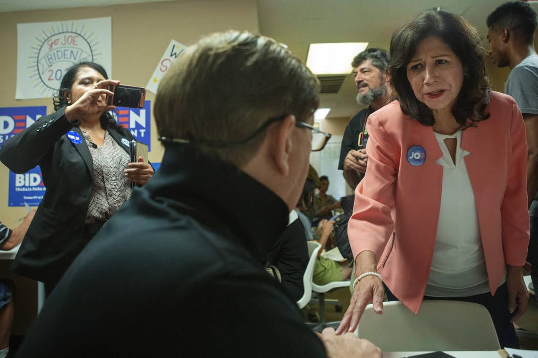 Former Labor Secretary Hilda Solis speaks with Joe Biden campaign staffer Rick Carter, from Hen ...