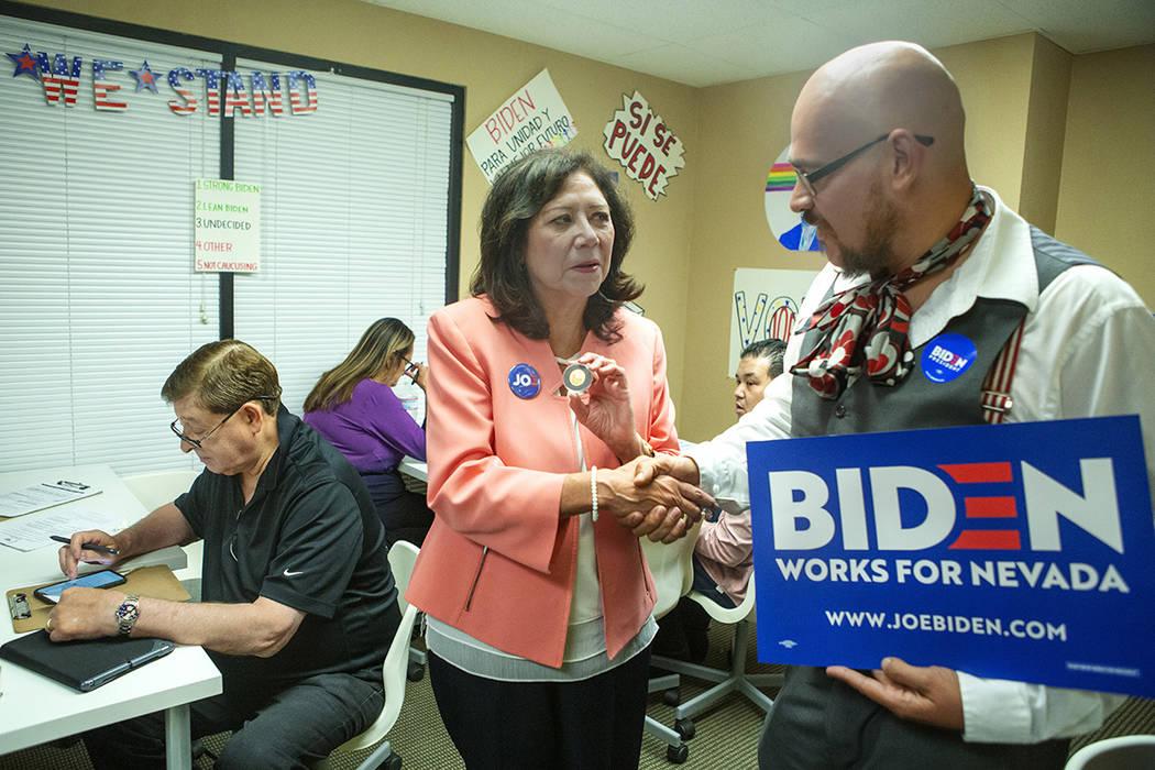 Former Labor Secretary Hilda Solis shakes hands with Joe Biden campaign staffer Gil Lopez at th ...