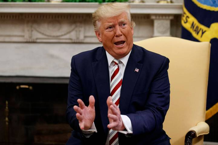 President Donald Trump speaks during a meeting with Romanian President Klaus Iohannis in the Ov ...