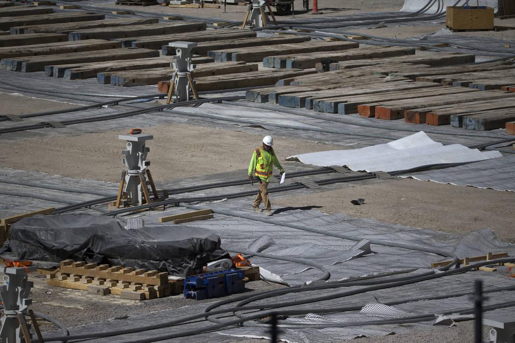 A workers walks the floor level of the Raiders Allegiant Stadium construction site in Las Vegas ...