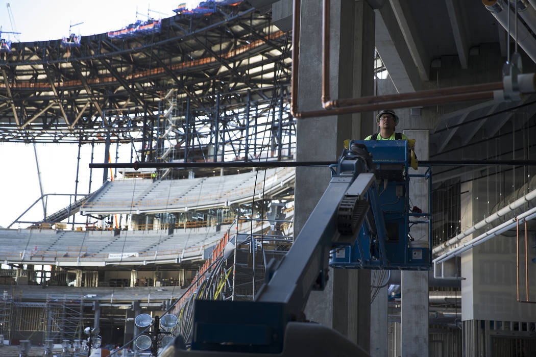 A laborer works at the Raiders stadium construction site in Las Vegas, Wednesday, Aug. 28, 2019 ...