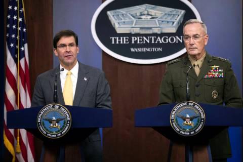 Secretary of Defense Mark Esper and Joint Chiefs Chairman Gen. Joseph Dunford speak to reporter ...