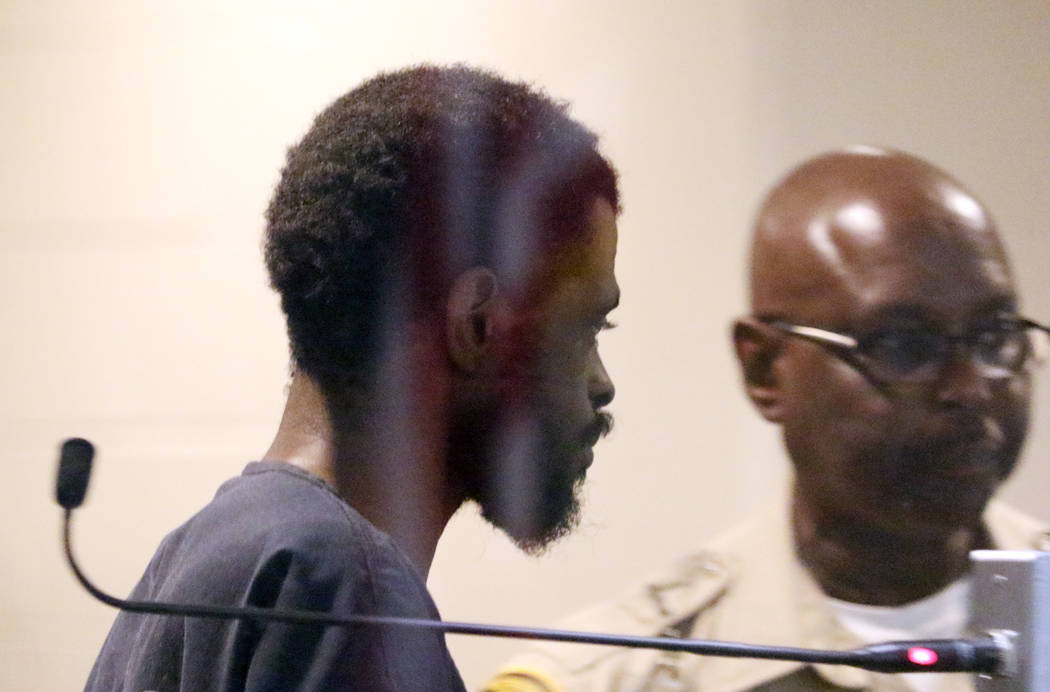 Clinton Taylor, accused of killing a woman with a sledgehammer, is led out of the courtroom aft ...
