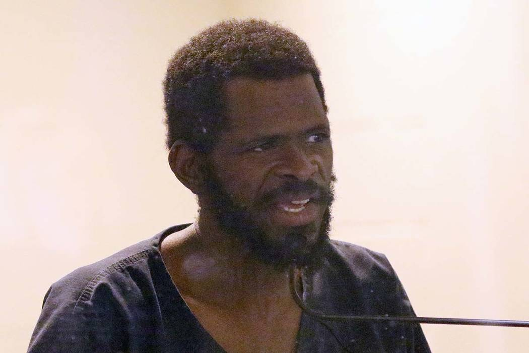 Clinton Taylor, accused of killing a woman with a sledgehammer, addresses the court during his ...
