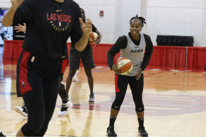 Las Vegas Aces' guard Epiphanny Prince, right, prepares to shoot the ball during team practice ...