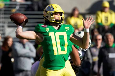 In this Dec. 31, 2018, file photo, Oregon quarterback Justin Herbert throws a pass during the f ...