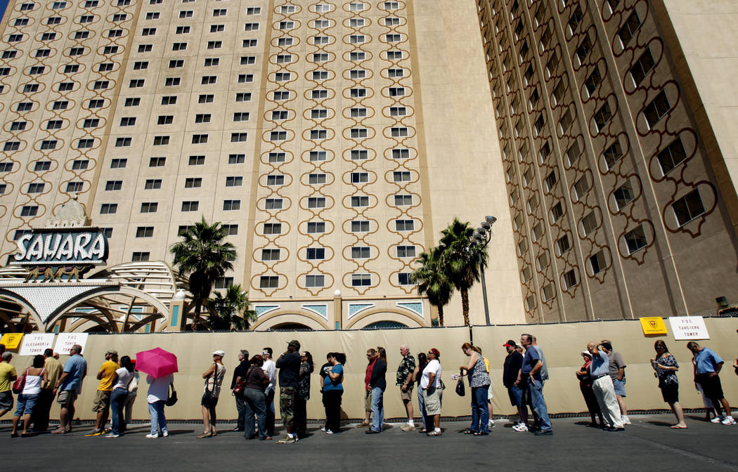 People stand in line to purchase memorabilia from the closed Sahara hotel-casino on the Las Veg ...