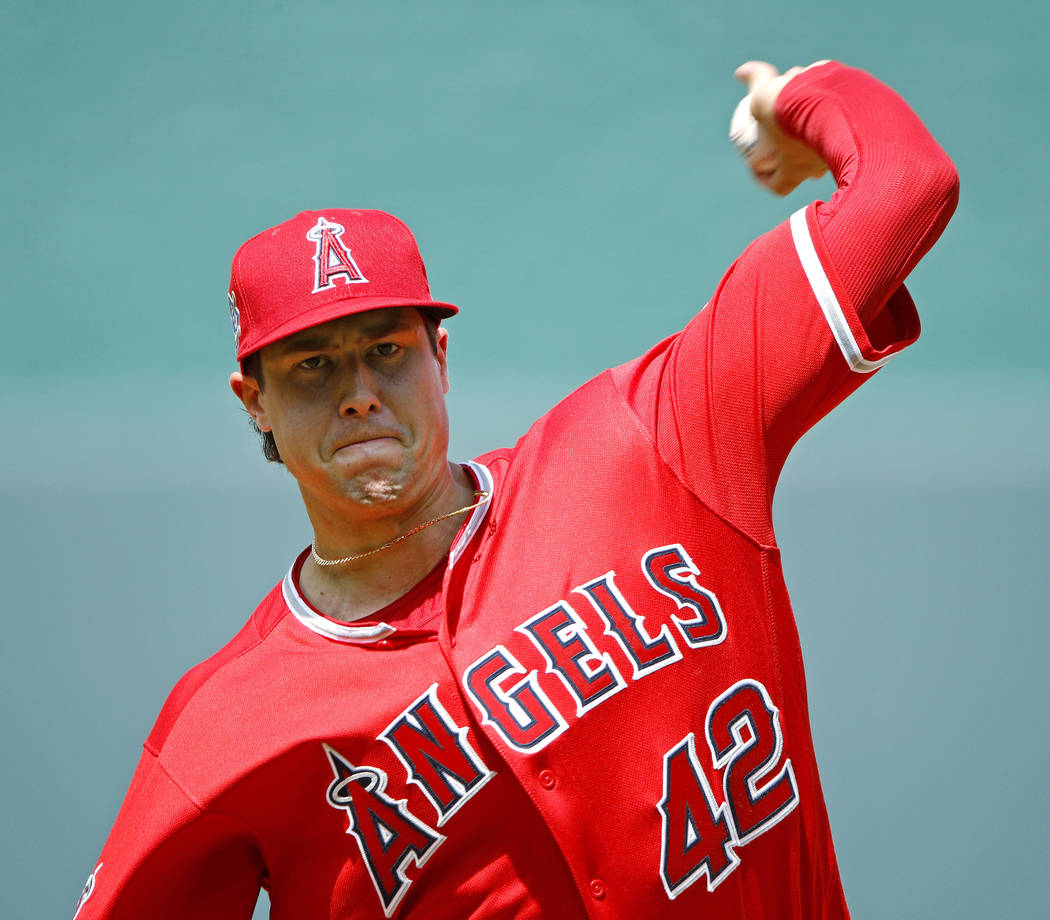 Los Angeles Angels starting pitcher Tyler Skaggs throws during a game against the Kansas City R ...