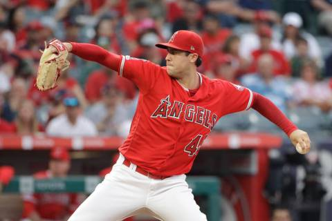 Los Angeles Angels starting pitcher Tyler Skaggs throws to the Oakland Athletics during a baseb ...