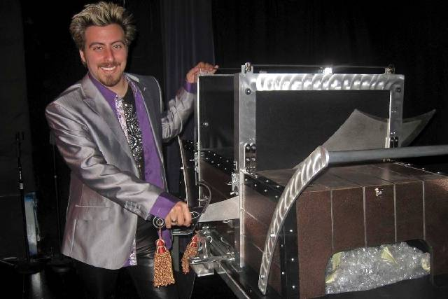 Master illusionist Tommy Wind demonstrates one of his magic tricks during an interview at the W ...