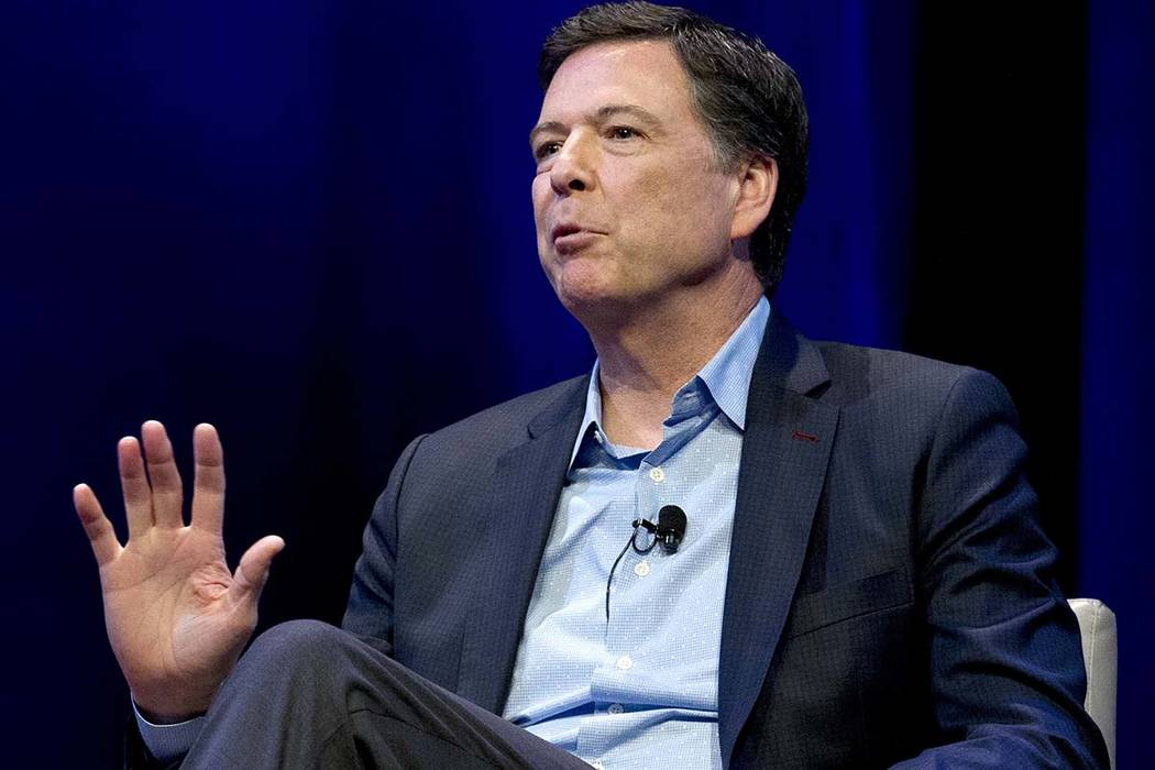 In this April 30, 2018, file photo, former FBI director James Comey speaks during a stop on his ...