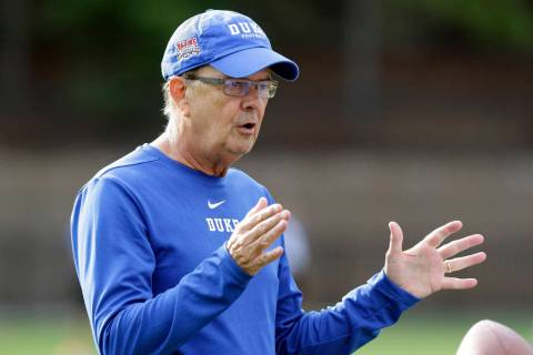 In this photo taken Friday, Aug. 2, 2019, Duke head coach David Cutcliffe directs his players d ...
