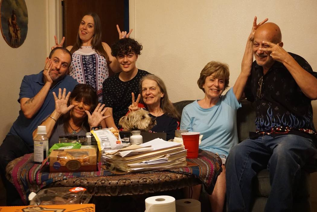Gail Sacco poses for a silly photo with her family. From left to right: her son Joe Sacco Jr., ...