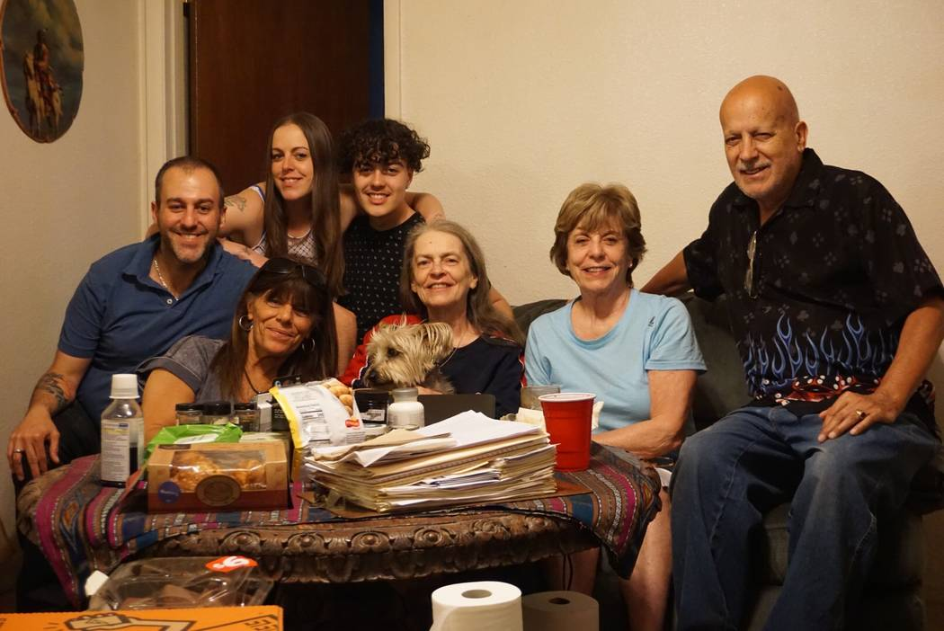 In this recent photo, Gail Sacco sits at the table with her family. From left to right: her son ...
