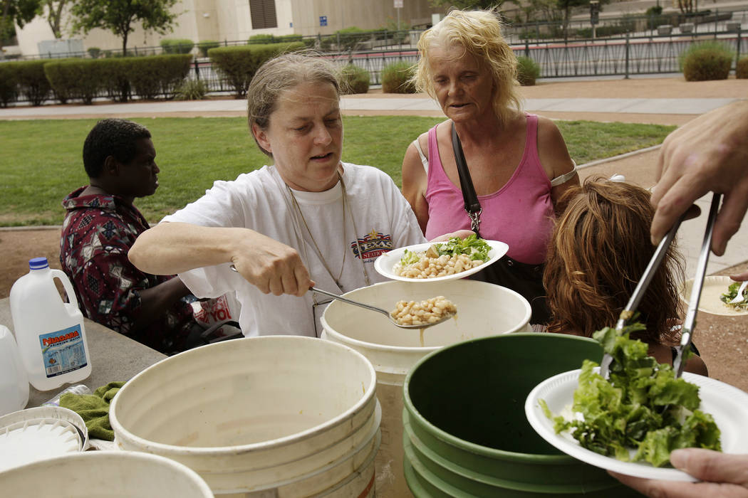 Homeless advocate Gail Sacco, left, feeds the homeless at Frank Wright Plaza in 2007 in downtow ...