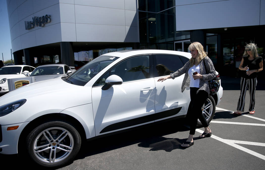 Melanie Cohen, left, and Ann Sachs, both of Las Vegas, prepare to test drive a Macan at Gaudin ...