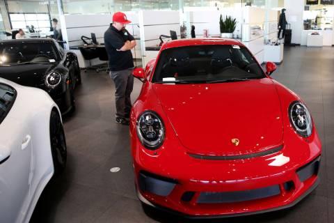 John Stephens of Las Vegas checks out a 2018 911 GT3 at Gaudin Porsche in Las Vegas Friday, Aug ...