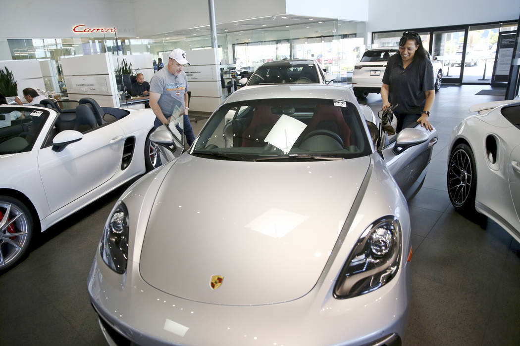 Stefanie and Ian Coffee of Las Vegas check out a 718 Cayman GTS Porsche at Gaudin Porsche in La ...