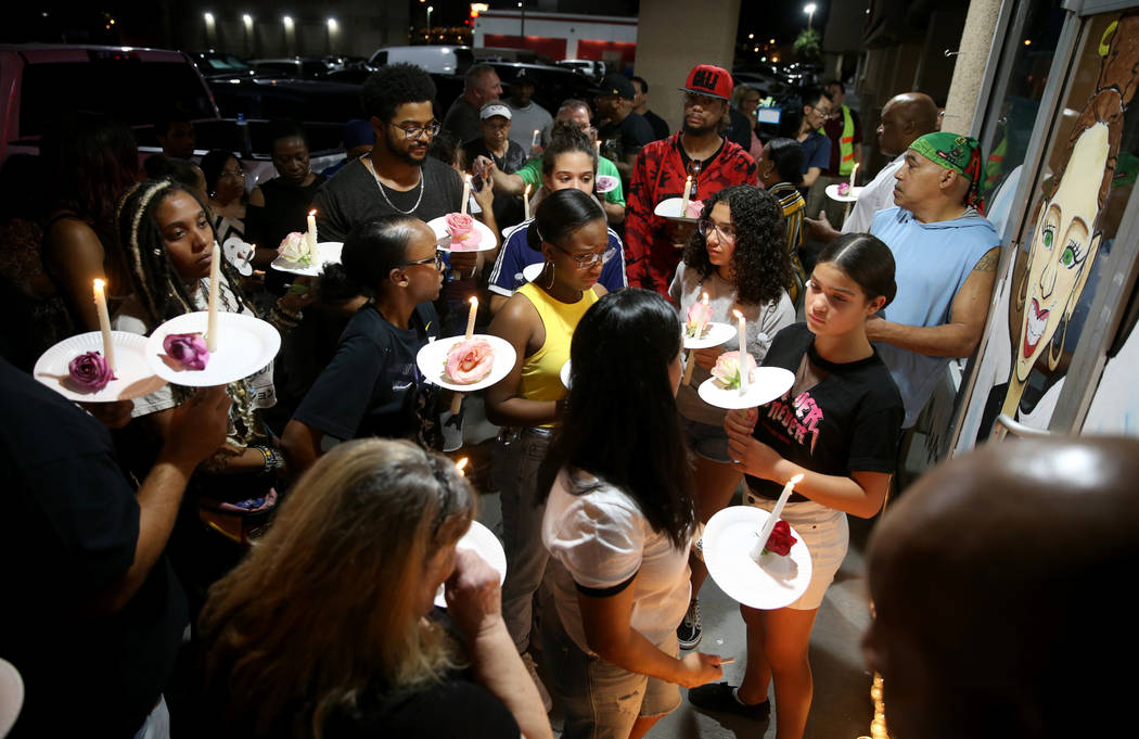 Mourners gather during a vigil Friday, Aug. 30, 2019, at TC's World Famous Rib Crib in Las Vega ...