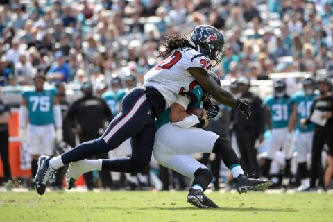In this Oct. 21, 2018, file photo, Jacksonville Jaguars quarterback Cody Kessler is sacked by H ...