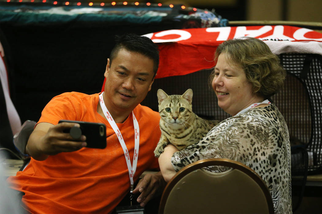Marlon Azada, left, of Houston, and his friend Irene Van Belzen of the Netherlands, take a phot ...