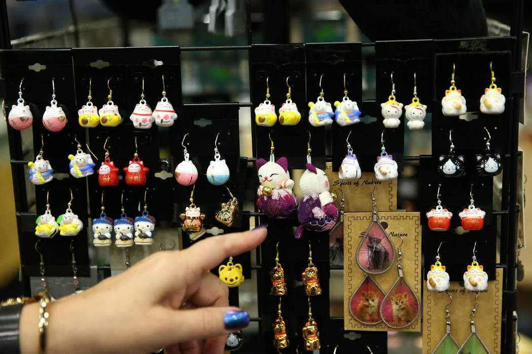 Cat themed earrings for sale by Paws and Pals during The International Cat Association's ...