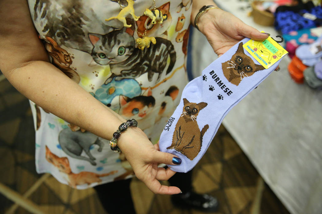 Cat themed socks for sale by Paws and Pals during The International Cat Association's (T ...