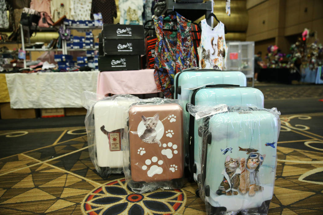 Cat themed merchandise for sale by Paws and Pals during The International Cat Association&#x201 ...