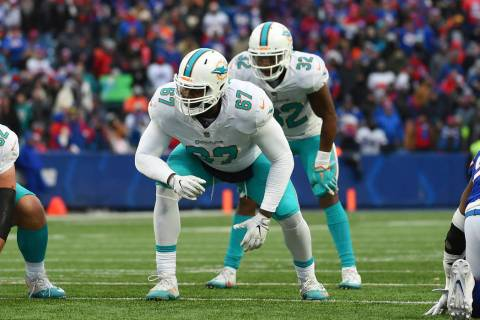 In this Dec. 17, 2017, file photo, Miami Dolphins offensive tackle Laremy Tunsil (67) lines up ...