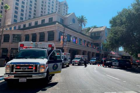Fire crews gather on Market Street outside the Hotel Fairmont in downtown San Jose, Calif., aft ...