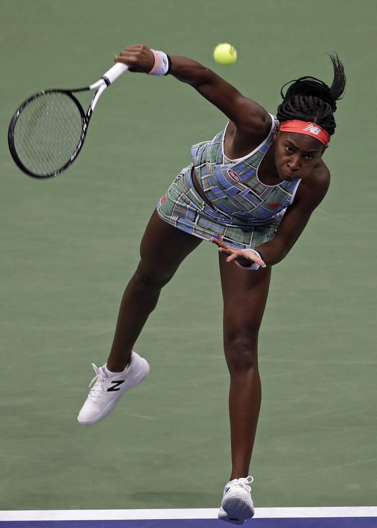 Coco Gauff serves to Naomi Osaka, of Japan, during the third round of the U.S. Open tennis tour ...