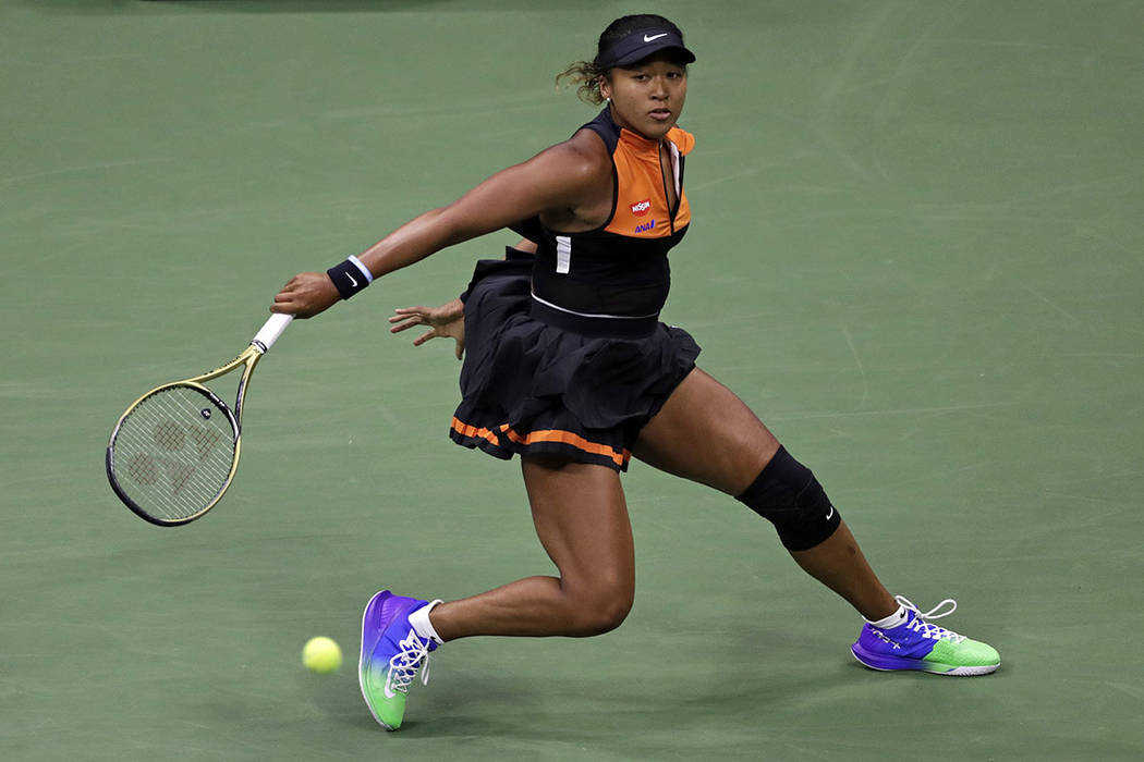 Naomi Osaka, of Japan, returns a shot to Coco Gauff during the third round of the U.S. Open ten ...
