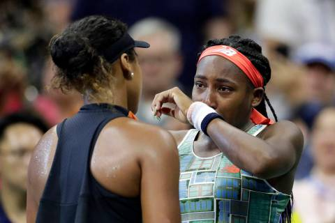 Coco Gauff, right, of the United States, wipes away tears while talking to Naomi Osaka, of Japa ...