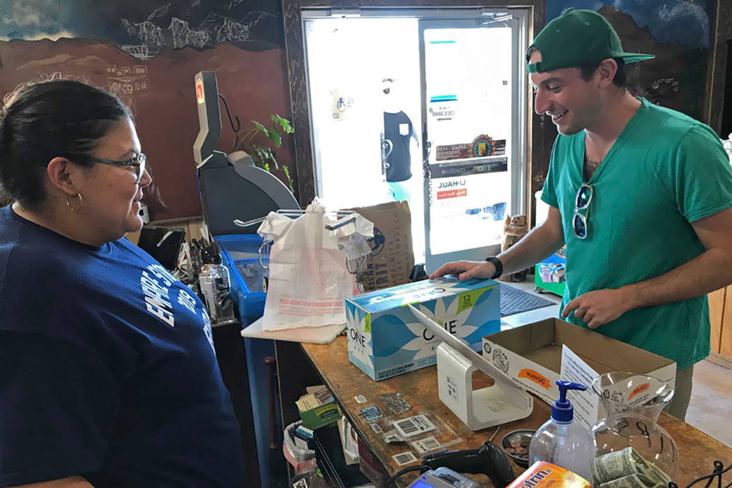 Jeremy Keesh, a Burning Man attendee from Chicago, buys coconut water at the Empire Store from ...