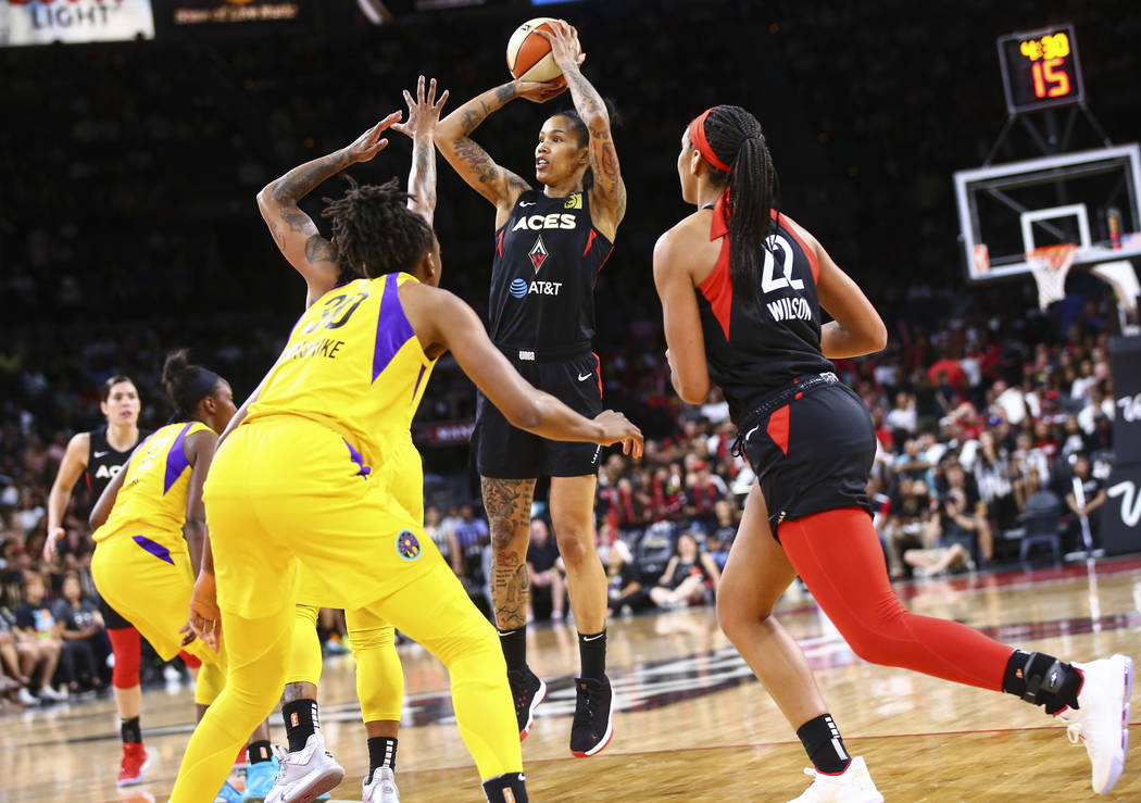 Las Vegas Aces' Tamera Young (1) shoots against the Los Angeles Sparks during the first half of ...