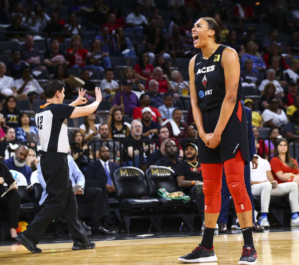 Las Vegas Aces' center Liz Cambage (8) reacts after a foul was called on her during the first h ...