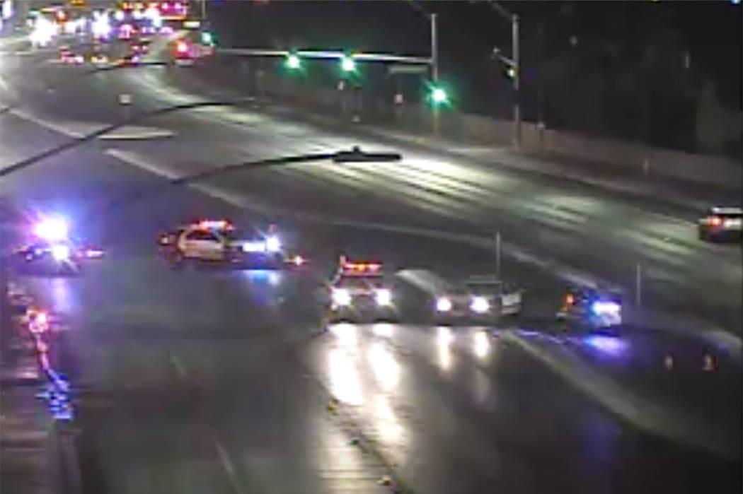 Las Vegas police close off southbound Rainbow Boulevard, north of Charleston Boulevard, on Satu ...