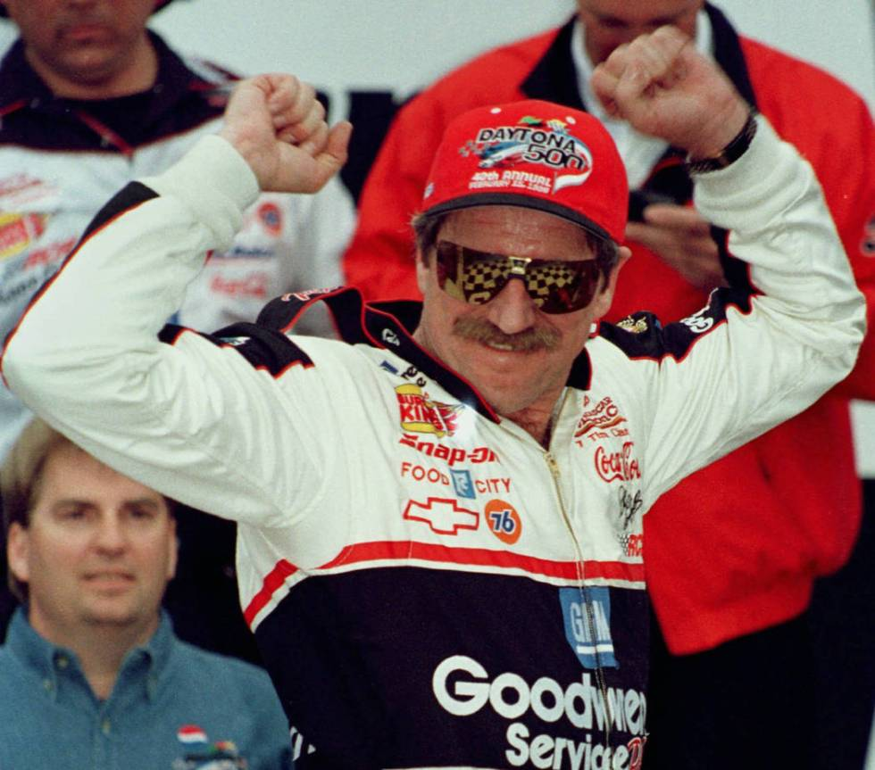 Dale Earnhardt has Victory Lane reflected in his sunglasses as he celebrates winning the Dayton ...