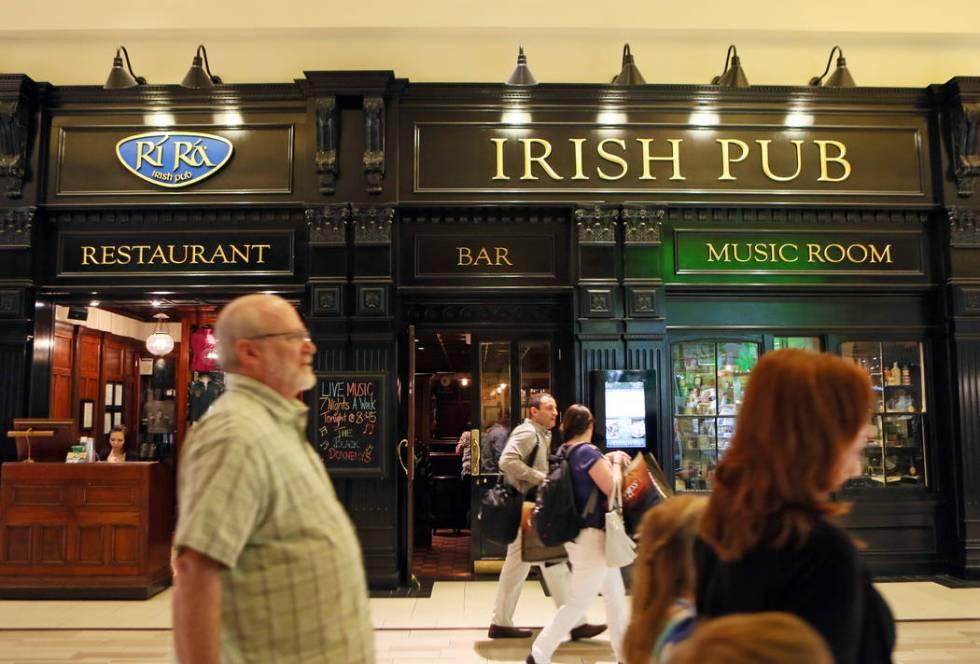People walk past Ri Ra Irish Pub at Mandalay Place Thursday, March 5, 2015, in Las Vegas. (Rond ...